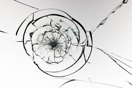 Photo pour Round cracks in glass on white background. The hole in the glass surface from the bullet. - image libre de droit
