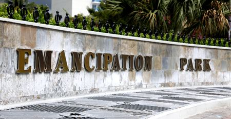 Kingston, Jamaica - December 20, 2009 - The Emancipation Park sign on a wall.