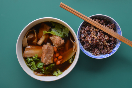 Bowl of Bak Kut Teh with brown rice from top view