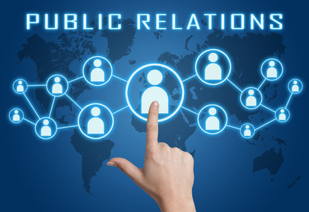 Public Relations concept with hand pressing social icons on blue world map background.