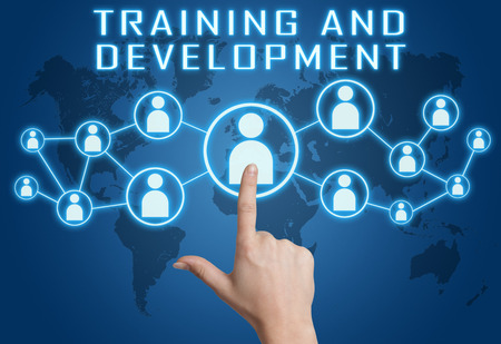 Training and Development concept with hand pressing social icons on blue world map background.