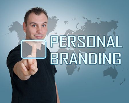 Young man press digital Personal Branding button on interface in front of him