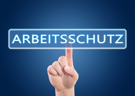 Arbeitsschutz - german word for employment protection - hand pressing button on interface with blue background.