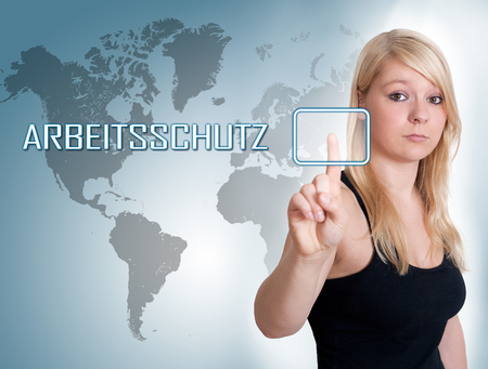 Arbeitsschutz - german word for work safety - young woman press button on interface in front of her