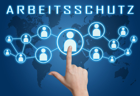 Arbeitsschutz - german word for work safety concept with hand pressing social icons on blue world map background.