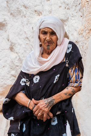 Tunisia - Berber old woman in a rural village, with tipical tribal tattoo