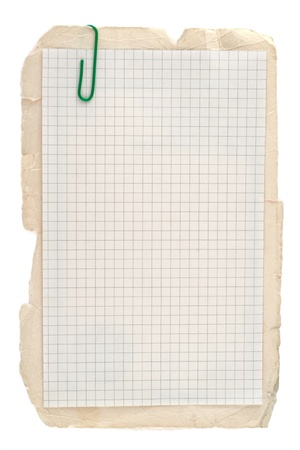 Checked notebook paper on old grungy cardboard background