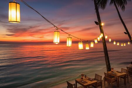 Photo for Outdoor cafe on the beach during sunset on Koh Chang island, Thailand. - Royalty Free Image