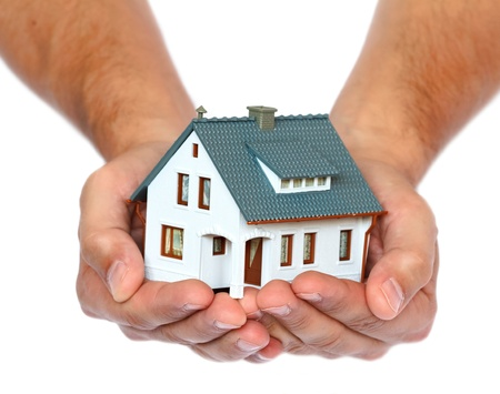 miniature house in hands