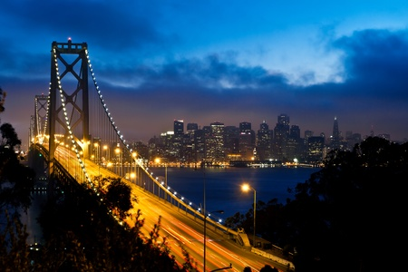 Foto de Bay Bridge with San Francisco city view after sunset - Imagen libre de derechos