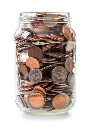 Jar full of coins isolated on white