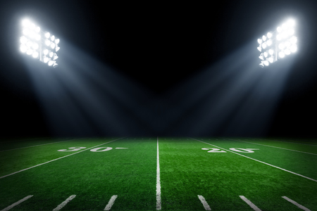 Photo for American football field at night with stadium lights - Royalty Free Image