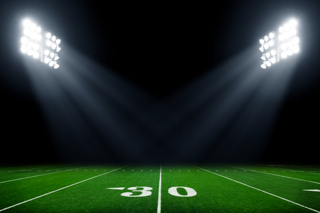 Photo pour American football field at night with stadium lights - image libre de droit