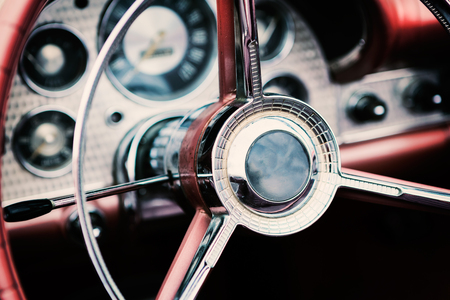 Classic car with close-up on steering wheel