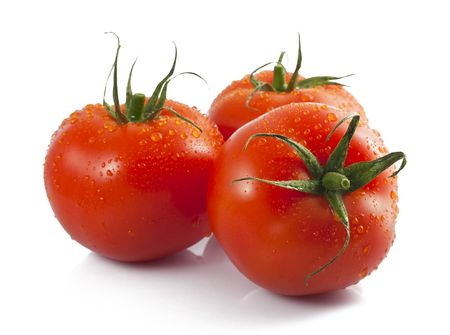 Three ripe tomatoes with water drops