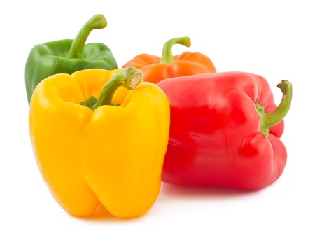 Four ripe peppers isolated on white background