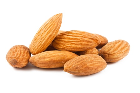 Composition from almond nuts isolated on white background