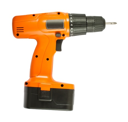 Cordless orange drill with black battery isolated on white background