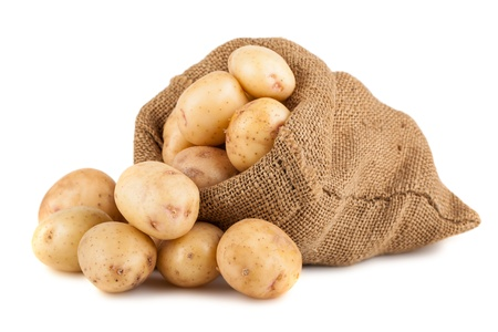 Ripe potato in burlap sack isolated on white background