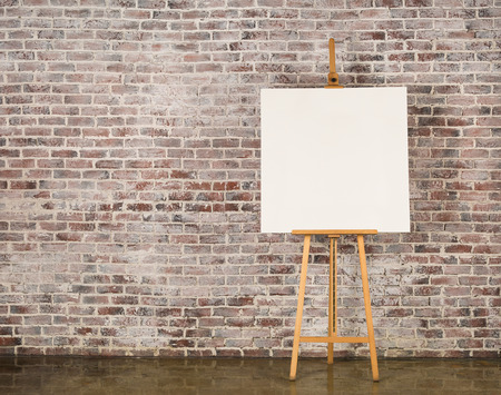 Photo pour Easel with blank canvas on a brick wall background - image libre de droit