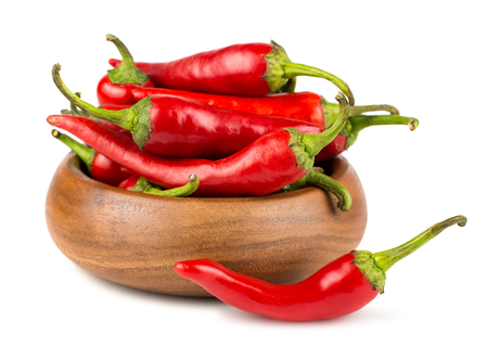 Red hot chili peppers in wooden bowl on white background