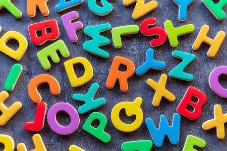 Photo pour colorful mixed letters pile on a granite table, top view - image libre de droit