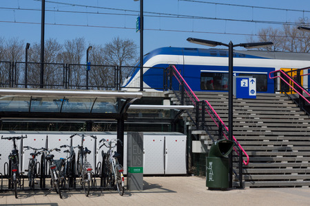 Sassenheim, The  Netherlands - april 24, 2015 - Bicycle parking at the trainstation in Sassenheim