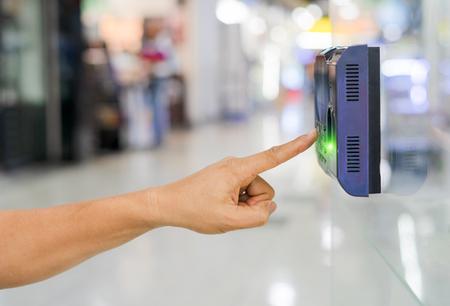 Foto de Track Employee Hours Using Biometric Fingerprint Scanner. - Imagen libre de derechos