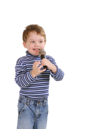 Photo pour Little boy with a microphone. Isolated on white  - image libre de droit