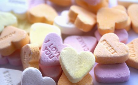 Background of multi color candy hearts with text