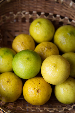 Yellow lemon in basket with natural lighting