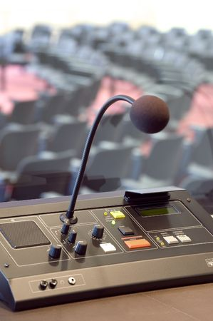 Microphone and switchboard in interpretors booth of a conference booth