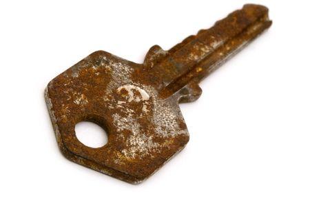rusty key on white background