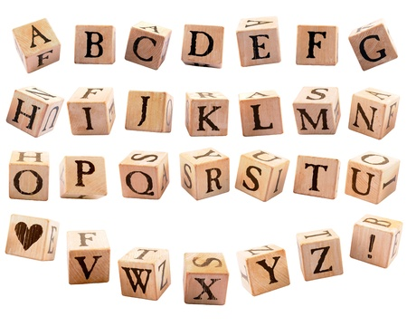 A set of rustic alphabet blocks, 26 letters, a heart shape and an exclamation point, each presented in a different orientation, as if they were falling   Isolated on white