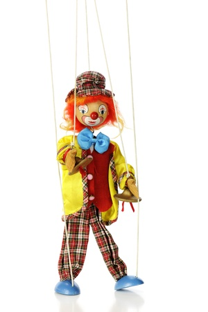 A clown marionette puppet isolated on white