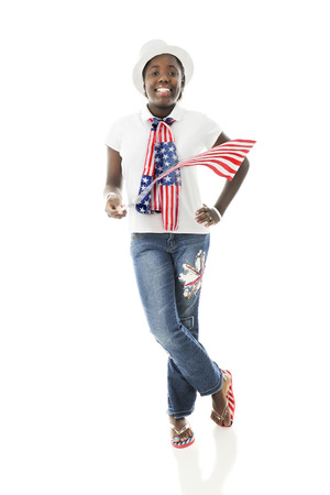 A pretty tween girl proudling wearing her country's colors while waving an American flag.  On a white background.