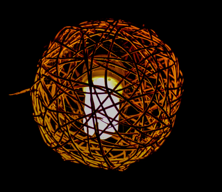 A golden lantern that makes a beautiful red contrast in the black night
