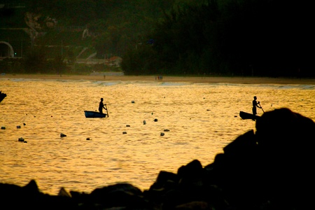 Locals are fishing in their basket boats at sunset in the golden bay