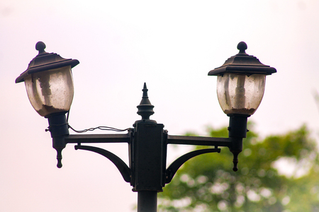 A poorly restored silhouette of a lamp post reflects the mood of the rainy day