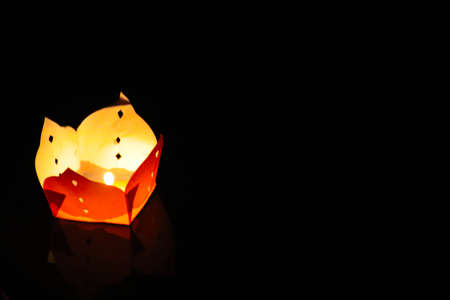 Photo for A lone lantern in the night during the Floating Lantern Festival also know as Loy Kratong or YeePeng Festival , celebrated in Thailand, Vietnam, Myanmar, Laos and Malaysia - Royalty Free Image