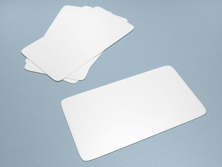 A set of blank business cards against a light blue background