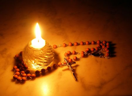Rosary and candle