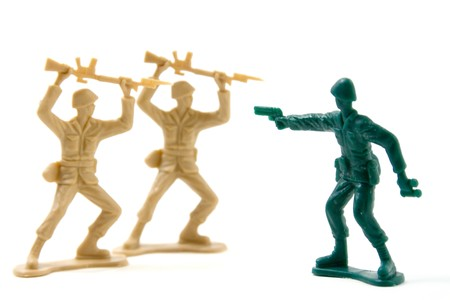 Isolated Plastic Toy Soldiers - Courage Concept