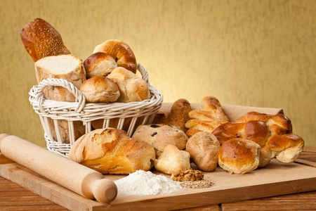 Basket of different types of gourmet brerad with flour, sesame seeds and nuts