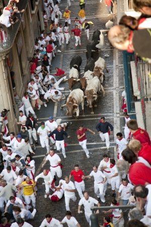 Pamplona, Navarra, Spain. People running by the bulls at San Fermin.