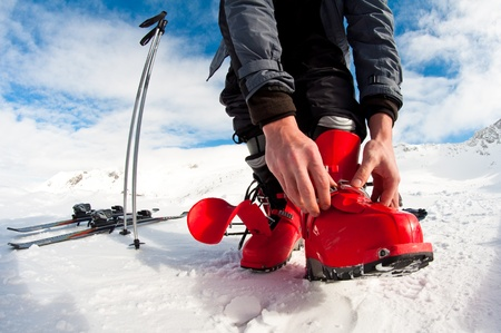 getting ready for skiing - fastening the boots