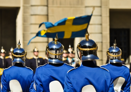 swedish soldiers with shiny helmets in front of the royal palace in stockholm