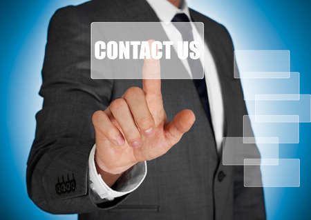 Businessman touching a contact us button