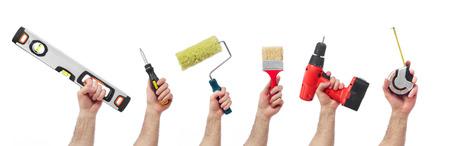 Photo pour Hands raised holding different tools - image libre de droit
