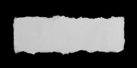 Piece of a paper isolated on black